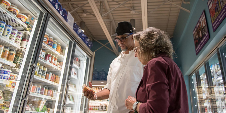 Photo of vocational peer support in grocery store